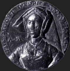"""Medalha de 1534 com o busto de Ana Bolena em que se lê a Inscrição """"The Most Happy"""" (A mais Feliz)."""