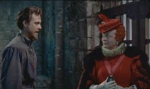 Em cena Richard Todd, como Sir Walter Raleigh, e Bette Davis como Elizabeth I.
